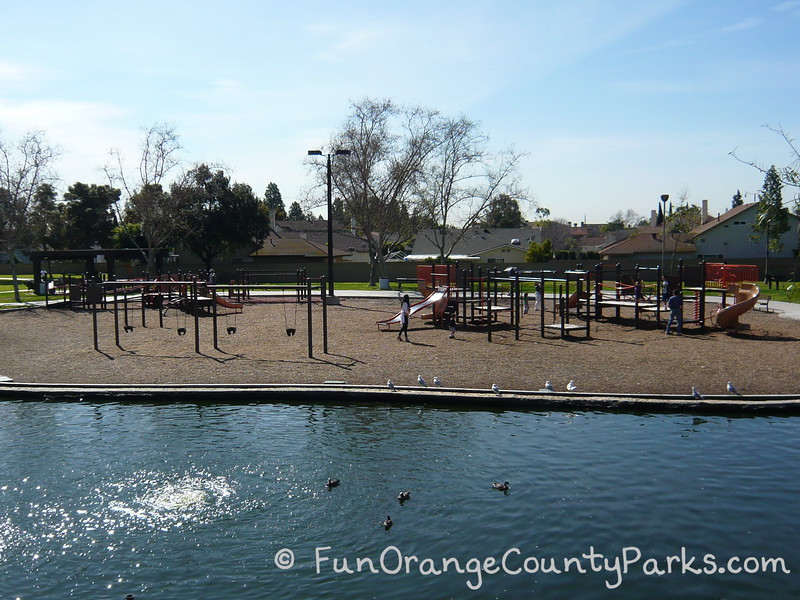 simple playground with swings and slides outside of heritage park play island in cerritos