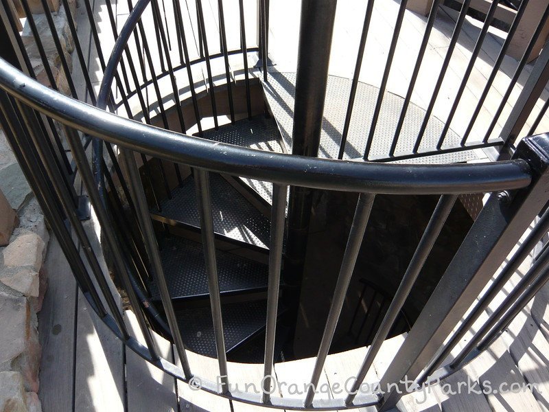 overhead view of a black iron spiral staircase where you can't see where it leads