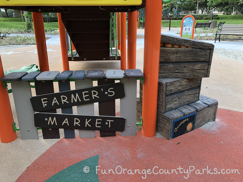 what looks like a mini Farmer's Market stand with orange crates stacked nearby which also serve as steps to access the structure
