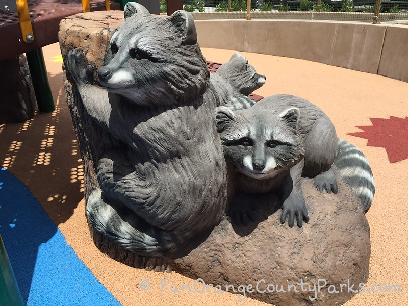 play statues of raccoons for kids to play and climb on the playground