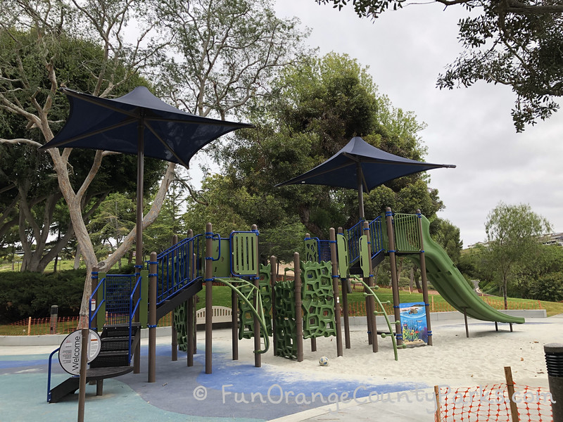 very tall play green and blue playground with slides