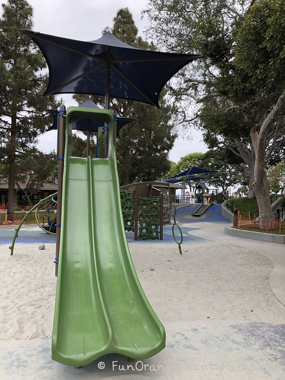 double green slides leading from big play structure