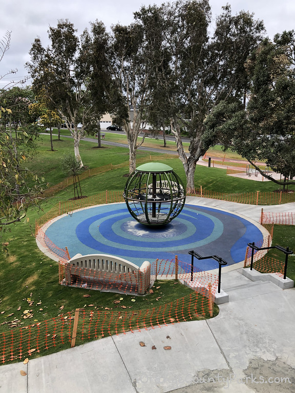 aerial view of the spinning globe equipment at Grant Howald Park in Newport Beach