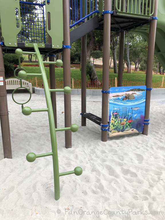 curved ladder with rungs that have baseball sized balls at the end