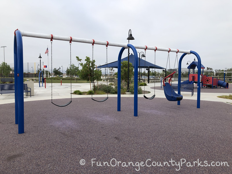 3 bench swings and one swinging chair on a playground