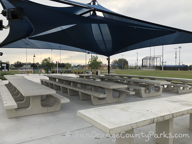covered picnic area with splash pad just beyond